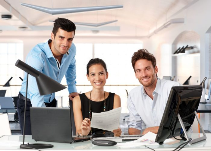36905425 - happy team of young business people working together in office.