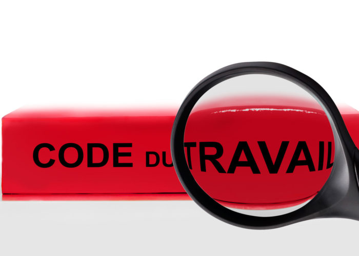81121414 - french labor code book and magnifying glass, labor code law reform in france concept