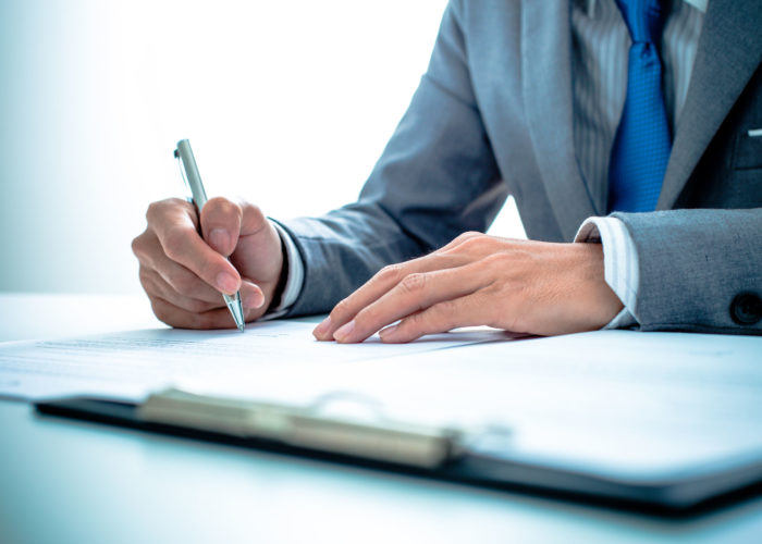 36704474 - business man signing a contract